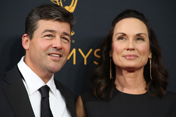 Actor Kyle Chandler and his wife Kathryn arrive at the 68th Primetime Emmy Awards in Los Angeles, California