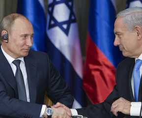 Russian President Putin and Israel's Prime Minister Netanyahu shake hands after delivering their joint statements in Jerusalem