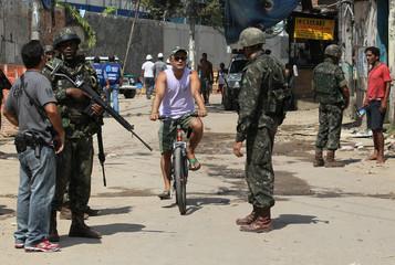 Army soldiers patrol a street in Rio de Janeiro