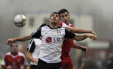 Accrington Stanley's Symes challenges Fulham's Hughes during their FA Cup soccer match in Accrington