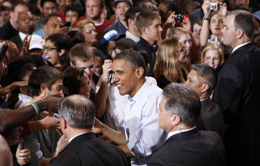 U.S. President Barack Obama greets supporters during a campaign rally at The  Ohio State University in Columbus