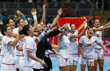 Montenegro's team celebrate after beating Spain in their women's semi-final match at the Basketball Arena during the London 2012 Olympic Games
