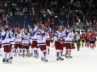 Russia's players celebrate victory against Canada after their quarter-final match at the Ice Hockey World Championships in Bratislava