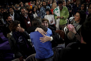 Iglesias, leader of Spain's Podemos party, is embraced by a woman as he arrives to a closing campaign rally in Dos Hermanas
