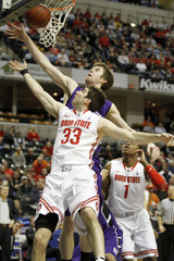 Northwestern's Shurna blocks Ohio State's Diebler during a mens Big Tenl tournament game in Indianapolis.