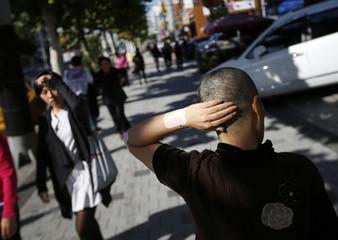 Kim Bok-soon walks on a street as she waits for a social worker in Seoul