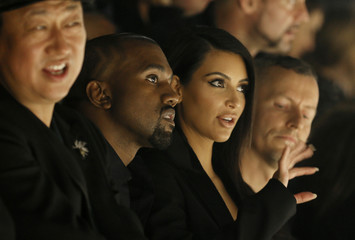 TV personality Kim Kardashian and rapper Kanye West attend the Israeli-American designer Alber Elbaz Spring/Summer 2015 women's ready-to-wear collection for fashion house  Lanvin during Paris Fashion Week