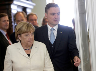 Germany's Chancellor Angela Merkel and Estonia's Prime Minister Taavi Roivas arrive for their meeting in Tallinn