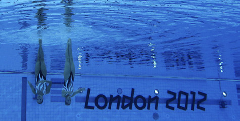 Japan's Yukiko Inui and Chisa Kobayashi are seen underwater as they perform in the synchronised swimming duets final during the London 2012 Olympic Games at the Aquatics Centre