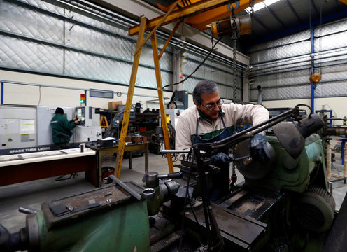 A labourer works at the Gottert machinery and tools plant factory in Garin, Argentina