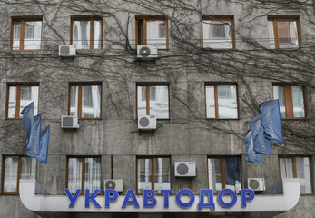 Logo of Ukrainian state road agency is pictured outside company's headquarters in Kiev