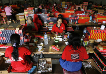 Employees work at making cigarettes in Sidoarjo, Indonesia's East Java province
