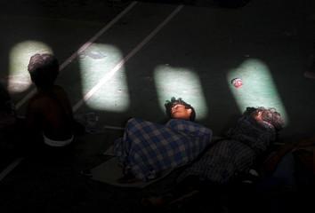 Migrants believed to be Rohingya sleep inside a shelter in Lhoksukon