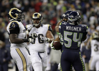 Seahawks' Wagner congratulates teammate Sherman during NFL football game against Rams in Seattle