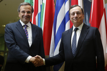 Greece's Prime Minister Samaras shakes hands with ECB President Draghi as he arrives at the ECB headquarters in Frankfurt