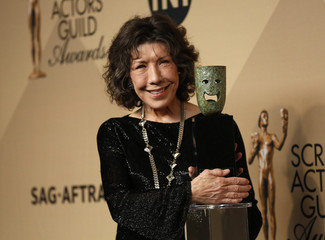 Actress Lily Tomlin poses with her Lifetime Achievement Award backstage at the 23rd Screen Actors Guild Awards in Los Angeles