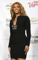 Singer Beyonce poses in the photo room after winning Billboard's Millennium award in Las Vegas