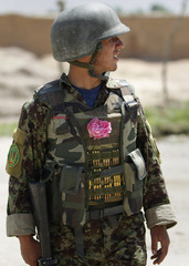 An Afghan National Army soldier wears a rose in his flak jacket during a joint patrol with U.S. forces in Jelawar in the Arghandab Valley north of Kandahar