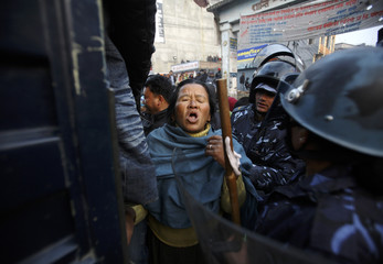 An activist is arrested by Nepalese police personnel during a general strike called on by landless squatters in Kathmandu