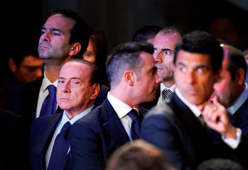 Italian Prime Minister Berlusconi looks on before delivering a speech during a two-day event in Rome
