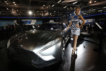 A model stands next to a Hyundai HND-9 Venace concept car during the Indian Auto Expo in Greater Noida