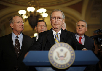Mitch McConnell speaks to the press following more debt reduction talks on Capitol Hill in Washington