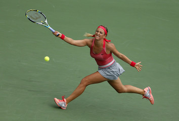 Azarenka of Belarus hits a return to Ivanovic of Serbia at the U.S. Open tennis championships in New York