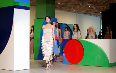 Models walk past geometric boxes during a runway show by Ginger and Smart at the Art Gallery of New South Wales at Fashion Week Australia in Sydney