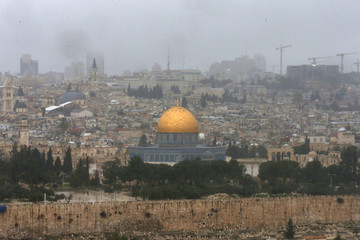 The Dome of the Rock and the compound known to Muslims as Noble Sanctuary and to Jews as Temple Mount are seen from outside Jerusalem's Old City during stormy weather.