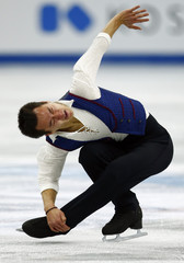 Chan of Canada performs during the men's free skating competition at the ISU Grand Prix of Figure Skating Final in Sochi