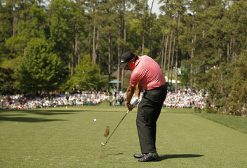 Phil Mickelson of the U.S. hits off the sixth tee during third round play of the Masters golf tournament at the Augusta National Golf Course in Augusta