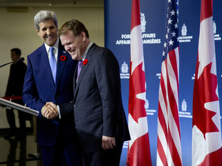 U.S. Secretary of State Kerry and his Canadian counterpart Baird shake hands after a joint news conference at the Canadian Department of Foreign Affairs in Ottawa