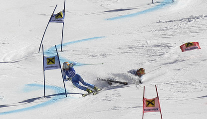 Sweden's Borssen and Stiegler from the U.S. speed down the slope in Schladming