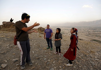 An Iranian paragliding instructor Mehran Rahbari gives instruction to an Afghan paraglider during training in Kabul