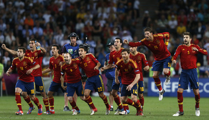 Spain's players celebrate after defeating Portugal in Euro 2012 semi-final soccer match in Donetsk