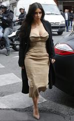 TV personality Kim Kardashian and rapper Kanye West arrive at a fashion designer workshop in Paris