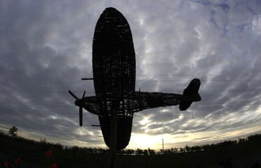 Model of a Spitfire fighter plane, built to commemorate the 70th anniversary of the Battle of Britain, is seen at dawn at Royal Air Force base Cottesmore in Rutland