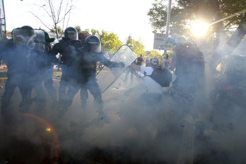Human rights supporters clash with riot police during a protest against the launch of a book on retired Chilean Brigadier Krassnoff in Santiago