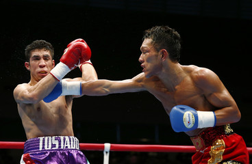 Akaho of Japan fights with Garcia of Mexico in the bantamweight class during a boxing bout in Tokyo