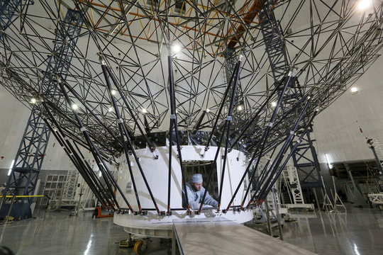 Fitter of space apparatus Budailov works on central mirror of Millimetron space observatory at large-sized transformed mechanical systems centre of the Reshetnev Information Satellite Systems company in Zheleznogorsk