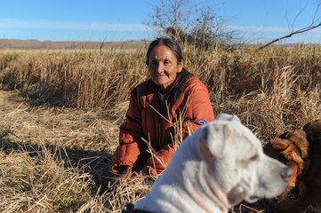 "Helen ""Granny"" Red Feather, an elder from the Lakota Sioux tribe in Wounded Knee, South Dakota, poses for a photograph while camping at a protest against the Dakota Access pipeline near the Standing Rock Indian Reservation near Cannon Ball, North Dakota"