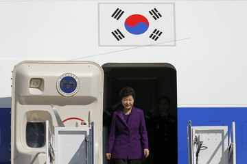 South Korea's President Park Geun-hye disembarks from her official plane to attend the upcoming Nuclear Security Summit meetings in Washington, on the tarmac at Joint Base Andrews, Maryland