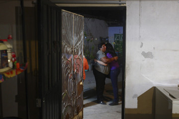 Edelmira Arias, the first cousin of inmate Edgar Tamayo, and America Tamayo, the niece of Tamayo, embrace at the Tamayo family house in Miacatlan