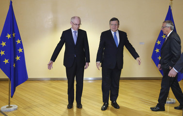 Outgoing EU Council Herman Van Rompuy and outgoing EU Commission President Barroso pose with incoming President of the European Commission Juncker in Brussels