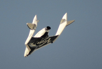 File photo of Virgin Galactic's SpaceShipTwo flies over the Mojave Desert shortly before successfully completing a test flight that broke the sound barrier