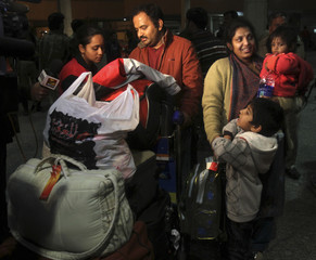 An Indian family residing in Libya arrives at the airport in New Delhi