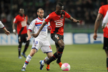 Tettey of Stade Rennes challenges Olympique Lyon's Lisandro during their French Ligue 1 soccer match at the Route de Lorient stadium in Rennes