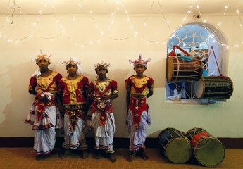 Sri Lankan traditional dancers pose for a photograph before the annual Perahera (street pageant) at Rajamaha viharaya Buddhist temple in Colombo, Sri Lanka