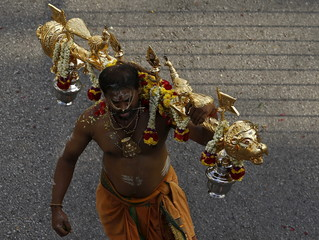 A devotee carries a kavadi during Thaipusam festival in Singapore