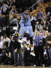 Grizzlies Gay celebrates with teammate Mayo after hitting the game winning shot against the Raptors during their NBA basketball game in Toronto